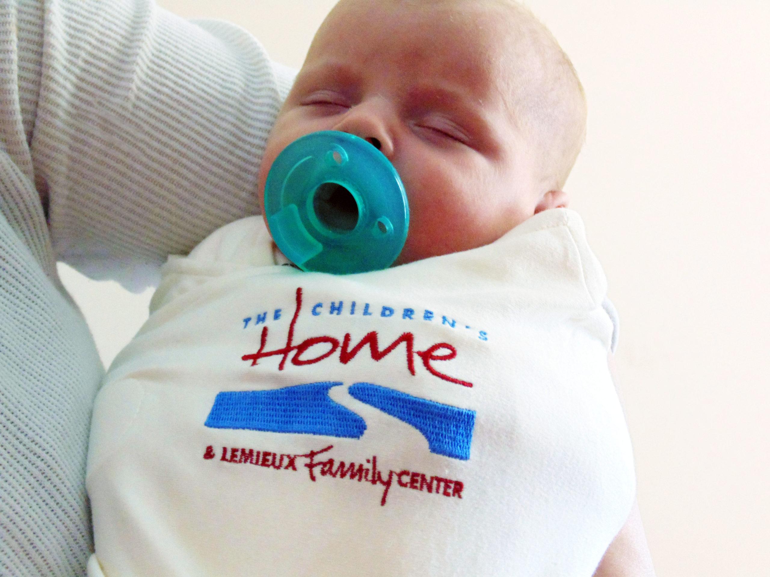 Baby in TCH Onesie